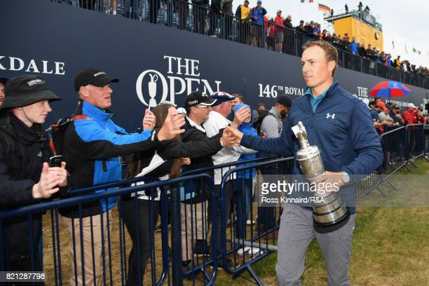 Jordan Spieth of the United States holds the Claret Jug and high fives fans after winning the 146th Open Championship at Royal Birkdale on July 23...