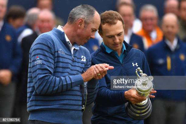 Jordan Spieth of the United States holds the Claret Jug and is congratulated by Matt Kuchar of the United States after winning the 146th Open...