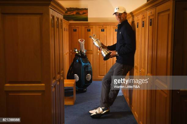 Jordan Spieth of the United States holds the Claret Jug in the locker room after winning the 146th Open Championship at Royal Birkdale on July 23...