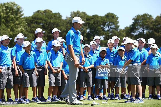 Jordan Spieth of the United States hosts a golf clinic for junior Australian golfers ahead of the 2015 Australian Open at The Australian Golf Course...