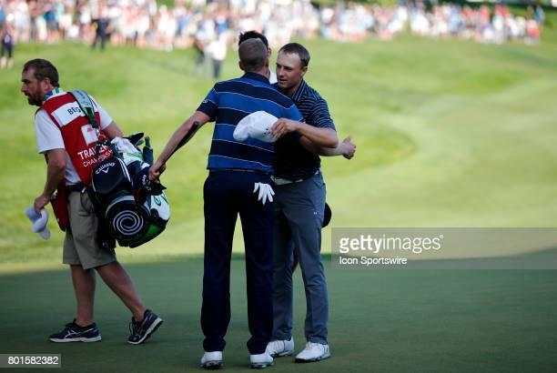 Jordan Spieth of the United States hugs Daniel Berger of the United States after winning the Travelers Championship on June 25 at TPC River Highlands...