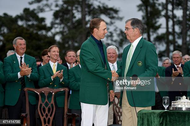 Jordan Spieth of the United States is congratulated by Billy Payne the Chairman of Augusta National Golf Club after the final round of the 2015...