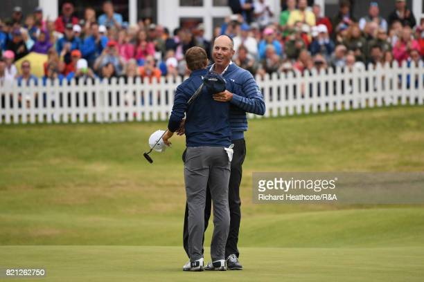 Jordan Spieth of the United States is congratulated by Matt Kuchar of the United States on the 18th green during the final round of the 146th Open...