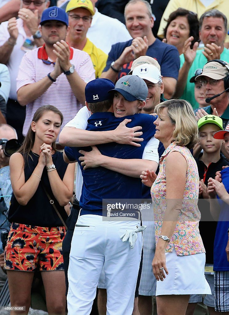 Jordan Spieth of the United States is greeted by his family behind the 18th green after Spieth's fourstroke victory at the 2015 Masters Tournament at...