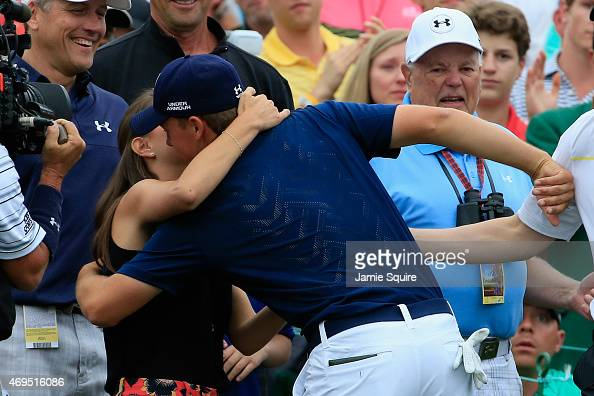 Jordan Spieth of the United States is greeted by his girlfriend Annie Verret behind the 18th green after Spieth's fourstroke victory at the 2015...