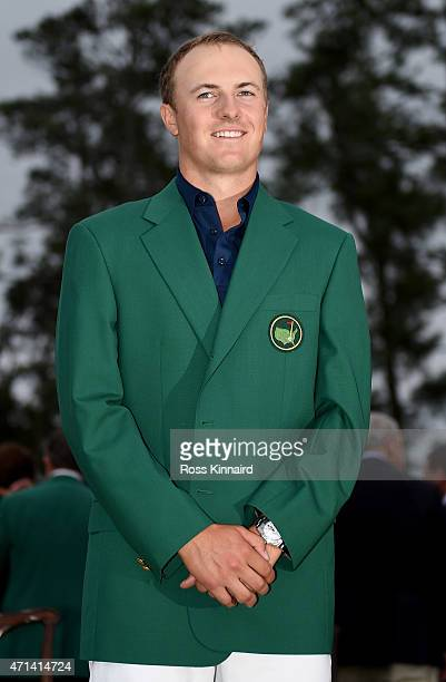 Jordan Spieth of the United States is presented with his Green Jacket after the final round of the 2015 Masters at Augusta National Golf Club on...