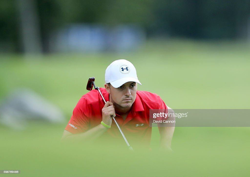 Jordan Spieth of the United States lines up a birdie putt on the 18th hole during the first round of the Deutsche Bank Championship at TPC Boston on September 2, 2016 in Norton, Massachusetts.