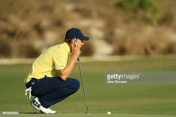 Jordan Spieth of the United States lines up a putt on the 18th green during the second round of the Hero World Challenge at Albany Bahamas on...