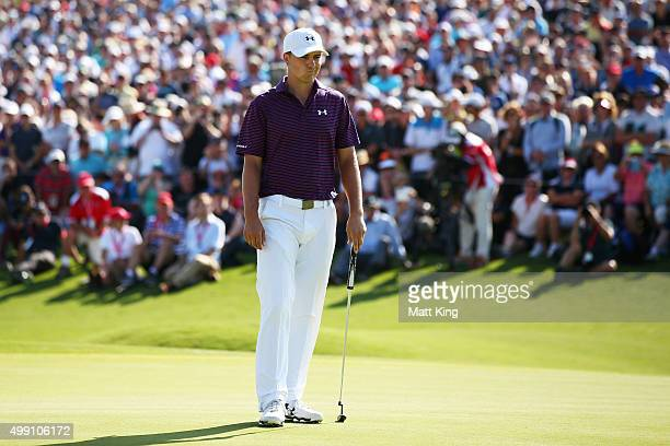 Jordan Spieth of the United States looks dejected after missing his eagle putt on the 18th green during day four of the Australian Open at The...