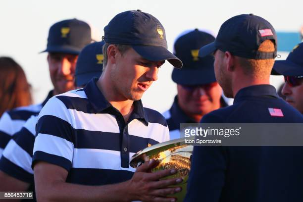 Jordan Spieth of the United States looks into the Presidents Cup Trophy after the Presidents Cup on October 1 at Liberty National Golf Clubin Jersey...