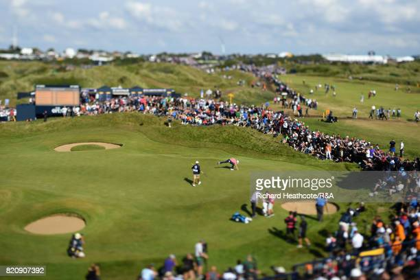 Jordan Spieth of the United States picks his ball from the hole on the 7th green during the third round of the 146th Open Championship at Royal...