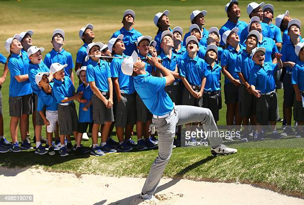Jordan Spieth of the United States plays a bunker shot as he hosts a golf clinic for junior Australian golfers ahead of the 2015 Australian Open at...