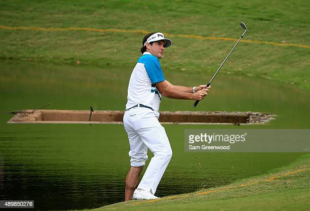 Jordan Spieth of the United States plays a shot fro the water's edge on the first hole during the first round of the TOUR Championship By CocaCola at...