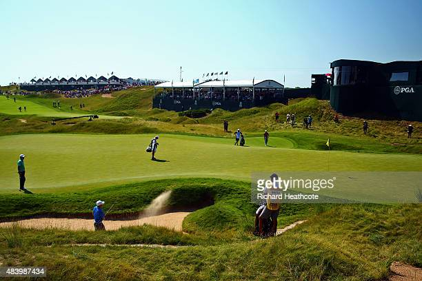 Jordan Spieth of the United States plays a shot from a bunker on the 18th hole during the second round of the 2015 PGA Championship at Whistling...