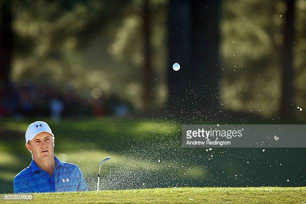 Jordan Spieth of the United States plays a shot from a bunker on the 17th hole during the final round of the 2016 Masters Tournament at Augusta...