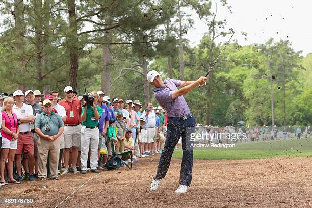Jordan Spieth of the United States plays a shot from the pine needles on the 14th hole during the second round of the 2015 Masters Tournament at...