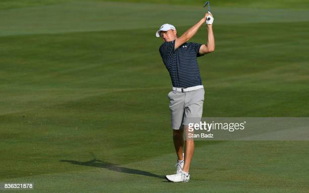 Jordan Spieth of the United States plays a shot on second fairway during course previews at Liberty National Golf Club host course of the 2017...