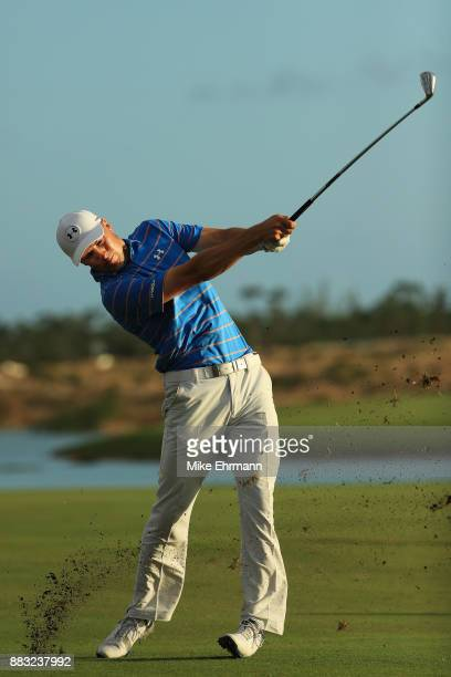Jordan Spieth of the United States plays a shot on the 18th hole during the first round of the Hero World Challenge at Albany Bahamas on November 30...