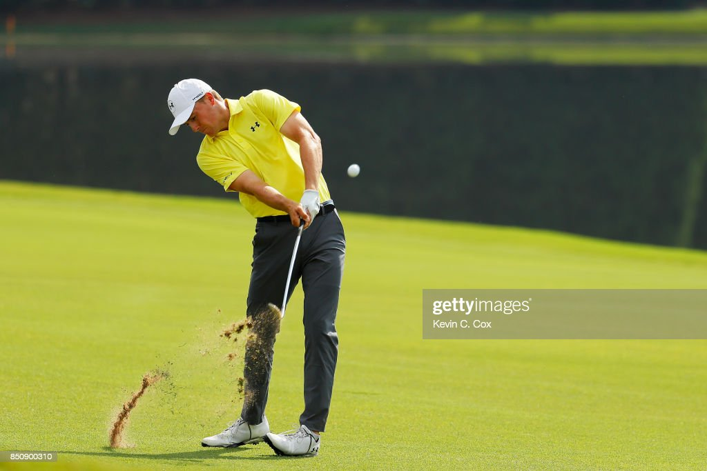Jordan Spieth of the United States plays a shot on the eighth hole during the first round of the TOUR Championship at East Lake Golf Club on September 21, 2017 in Atlanta, Georgia.