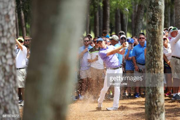 Jordan Spieth of the United States plays a shot on the sixth hole during the first round of THE PLAYERS Championship at the Stadium course at TPC...