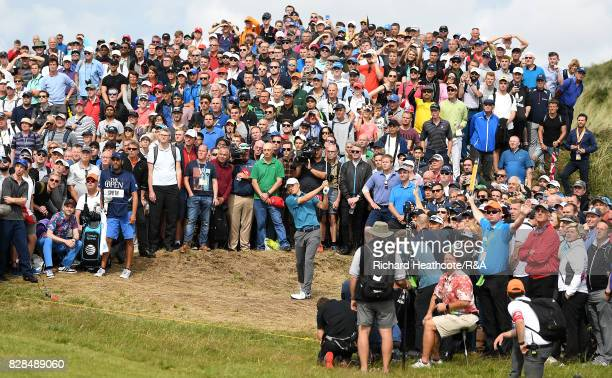 Jordan Spieth of the United States plays from the crowd on the 6th hole during the final round of the 146th Open Championship at Royal Birkdale on...