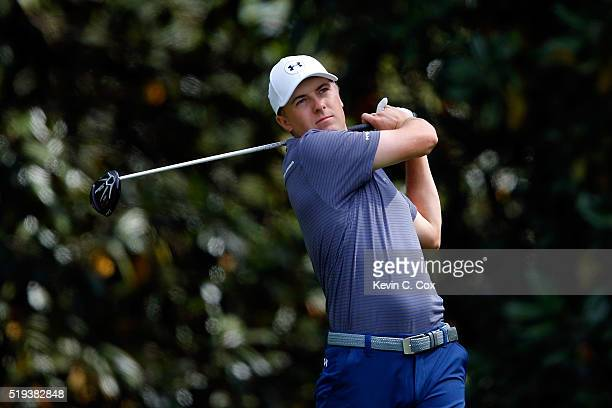 Jordan Spieth of the United States plays his shot from the 12th tee during a practice round prior to the start of the 2016 Masters Tournament at...