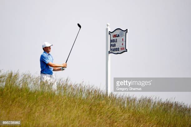 Jordan Spieth of the United States plays his shot from the fifth tee during a practice round prior to the 2017 US Open at Erin Hills on June 12 2017...