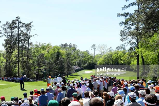 Jordan Spieth of the United States plays his shot from the fourth tee as patrons look on during the final round of the 2017 Masters Tournament at...