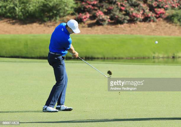 Jordan Spieth of the United States plays his third shot on the 12th hole during the final round of the 2017 Masters Tournament at Augusta National...
