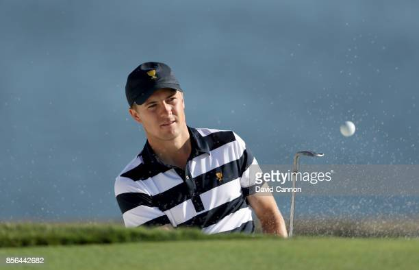 Jordan Spieth of the United States plays his third shot on the 14th hole in his match against Jhonattan Vegas of the International Team during the...