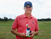 Jordan Spieth of the United States poses with his bobblehead during Round Three at the ATT Byron Nelson on May 21 2016 in Irving Texas