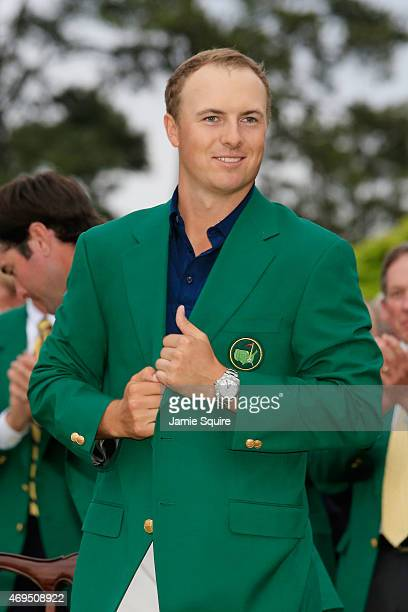 Jordan Spieth of the United States poses with the green jacket after winning the 2015 Masters Tournament at Augusta National Golf Club on April 12...