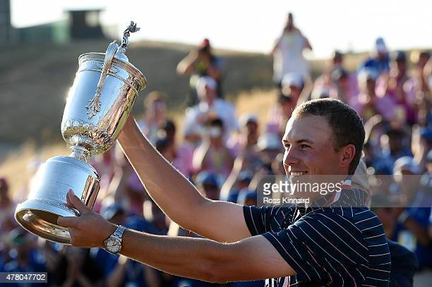 Jordan Spieth of the United States poses with the trophy after winning the 115th US Open Championship at Chambers Bay on June 21 2015 in University...