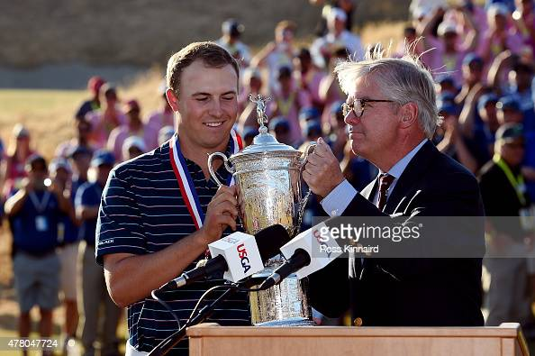 Jordan Spieth of the United States poses with the trophy alongside Thomas O'Toole Jr President of the USGA after Spieth won the 115th US Open...