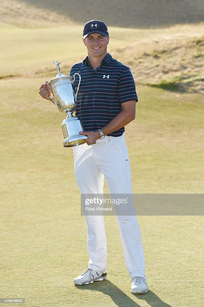 Jordan Spieth of the United States poses with the trophy for photographers after winning the 115th U.S. Open Championship at Chambers Bay on June 21, 2015 in University Place, Washington.