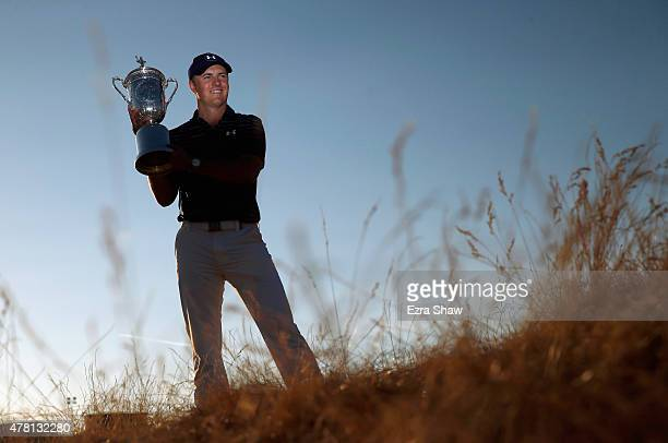 Jordan Spieth of the United States poses with the trophy for photographers after winning the 115th US Open Championship at Chambers Bay on June 21...