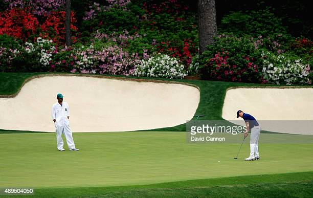 Jordan Spieth of the United States putts on the 13th green during the final round of the 2015 Masters Tournament at Augusta National Golf Club on...