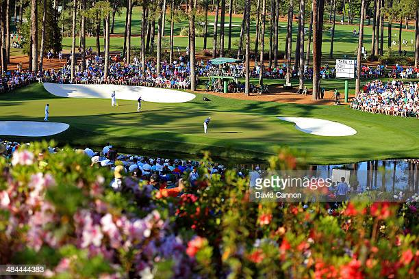 Jordan Spieth of the United States putts on the 16th green during the third round of the 2014 Masters Tournament at Augusta National Golf Club on...
