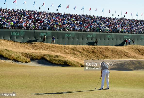 Jordan Spieth of the United States putts on the 18th green during the final round of the 115th US Open Championship at Chambers Bay on June 21 2015...