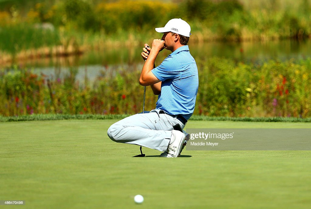 Jordan Spieth of the United States reacts after missing a putt on the sixteenth grren during round one of the Deutsche Bank Championship at TPC Boston on September 4, 2015 in Norton, Massachusetts.