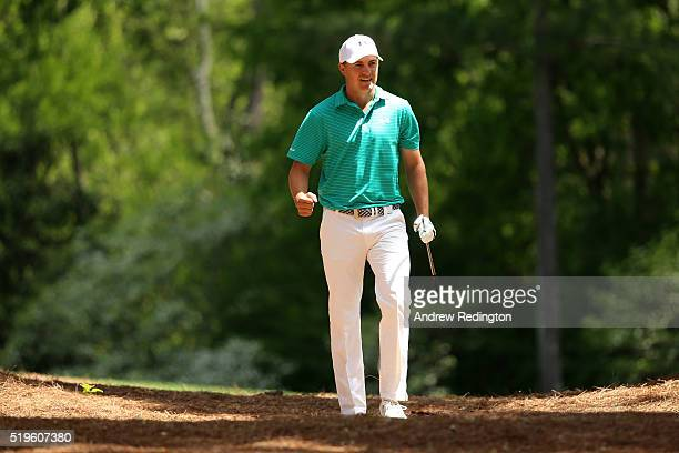 Jordan Spieth of the United States reacts after playing his second shot on the 11th hole during the first round of the 2016 Masters Tournament at...