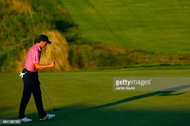 Jordan Spieth of the United States reacts after putting on the 18th green during the third round of the 2015 PGA Championship at Whistling Straits at...