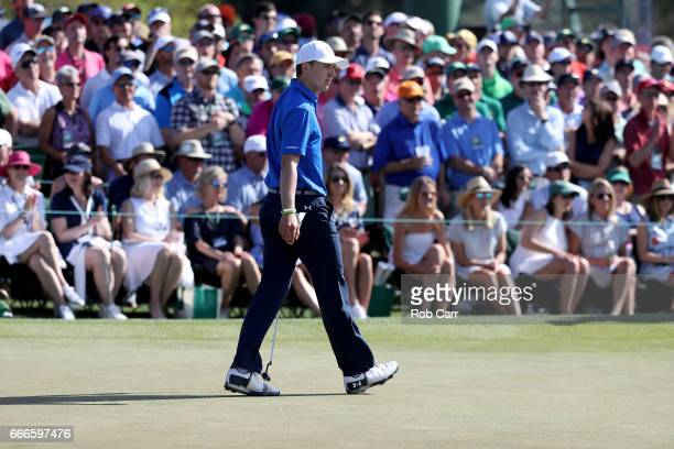 Jordan Spieth of the United States reacts to a par putt on the ninth hole during the final round of the 2017 Masters Tournament at Augusta National...