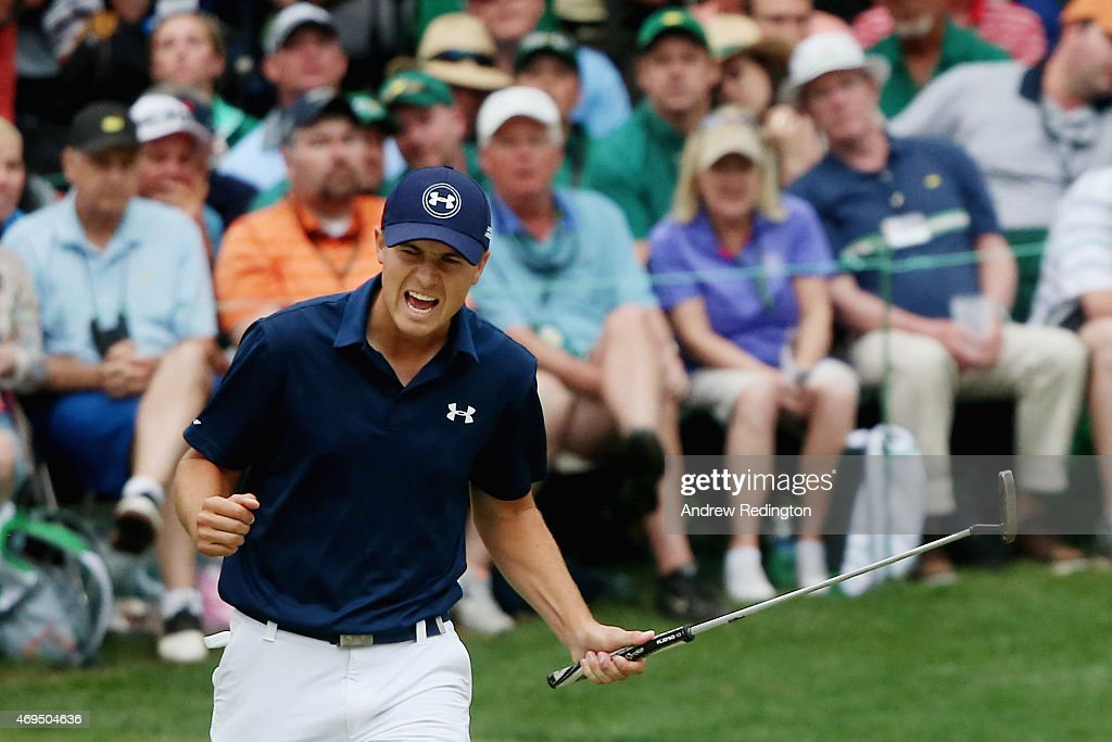 Jordan Spieth of the United States reacts to a parsaving putt on the 16th green during the final round of the 2015 Masters Tournament at Augusta...