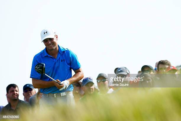 Jordan Spieth of the United States reacts to his tee shot on the 11th hole during the final round of the 2015 PGA Championship at Whistling Straits...