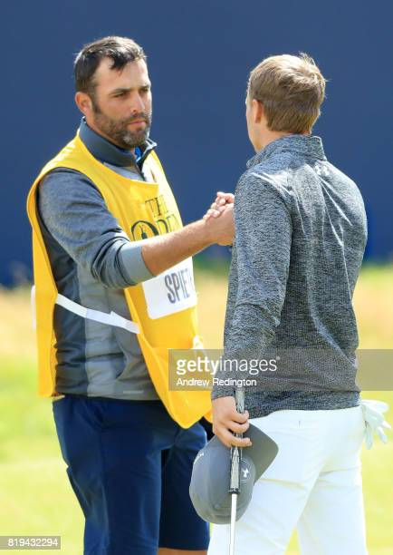 Jordan Spieth of the United States shakes hands with his caddie Michael Greller on the 18th green during the first round of the 146th Open...