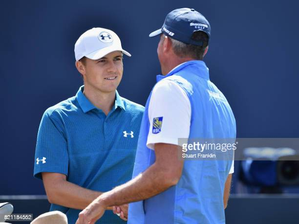 Jordan Spieth of the United States shakes hands with Matt Kuchar of the United States on the 1st tee during the final round of the 146th Open...