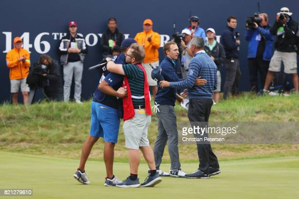 Jordan Spieth of the United States shakes hands with Matt Kuchar of the United States after victory on the 18th green during the final round of the...