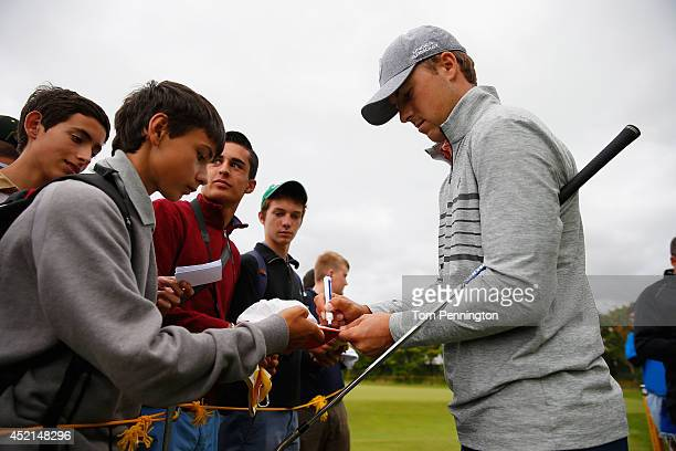 Jordan Spieth of the United States signs autographs during a practice round prior to the start of the 143rd Open Championship at Royal Liverpool on...