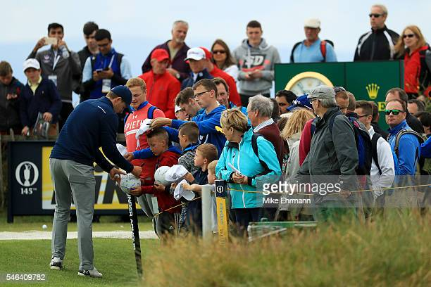 Jordan Spieth of the United States signs autographs during a practice round ahead of the 145th Open Championship at Royal Troon on July 12 2016 in...